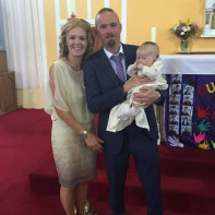 Sam Kate Collins with her parents on her baptism day.